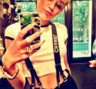 She's living the high life, Miley Cyrus keeps marijuana bling on her phone