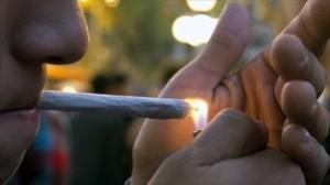man sparking a joint marijuana hbtv hemp beach tv